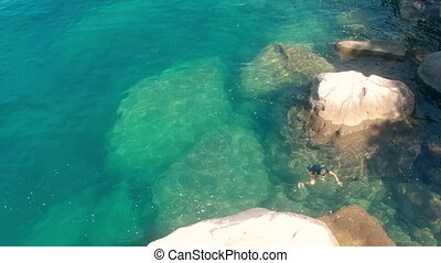 Woman Snorkling in Shallow Rocky Waters