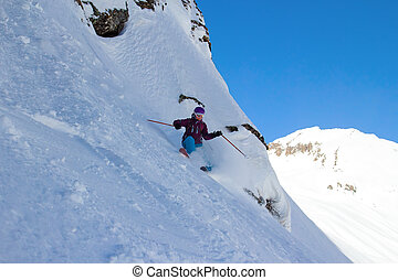 Woman Snow Skiing on Steep Slope with Mountain View - Woman...