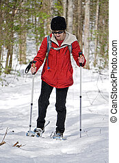 Woman Snowshoeing in the Woods