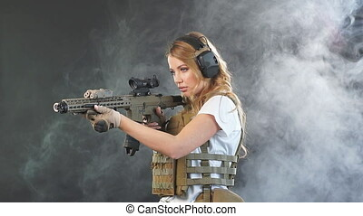 Woman soldier sniper in disguise with a sniper rifle, slow...