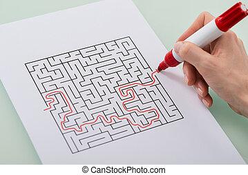 Woman Solving Maze Puzzle