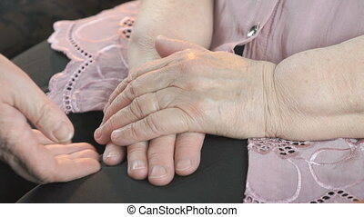 Woman soothes aged woman 80s in times of stress - Woman...