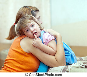 woman soothes crying child