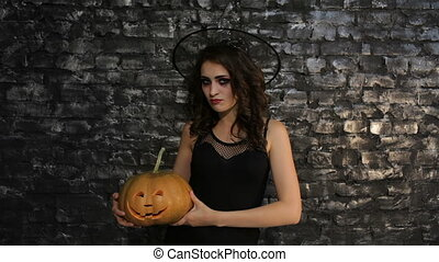 Woman-sorceress holds a pumpkin. Women in the image of the...