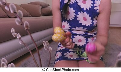 Woman sorting Easter eggs