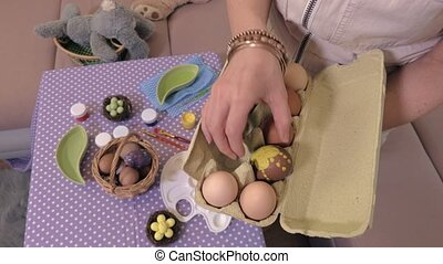 Woman sorting eggs near table