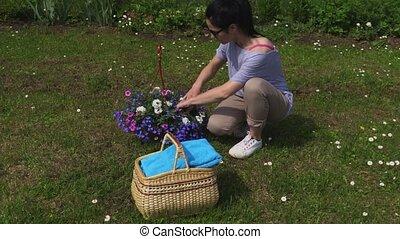 Woman sorting flowers in basket