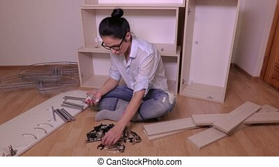 Woman sorting furniture fittings