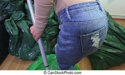 Woman sorts plastic bags