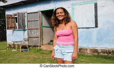 woman sound welcome to Island - native woman typical house...