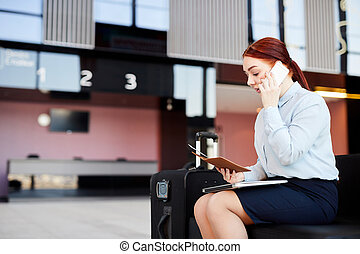 Woman Speaking by Phone in Airport