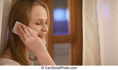 Woman speaking on her mobile smiling with pleasure