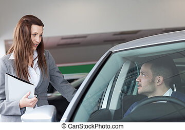 Woman speaking to a man
