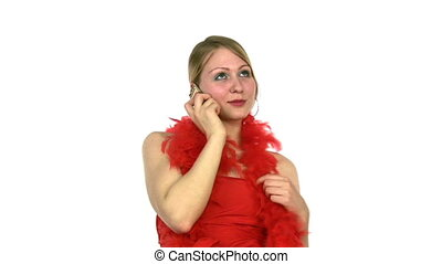 Woman speaks on phone in red dress and scarf