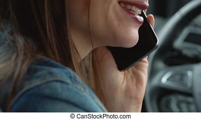 Woman speaks on the smartphone in the car