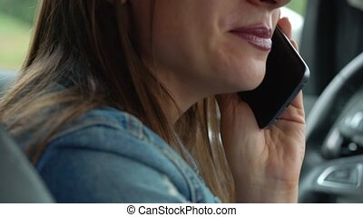 Woman speaks on the smartphone in the car - Beautiful woman...