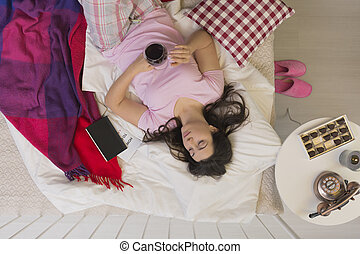 Woman spending evening in bed