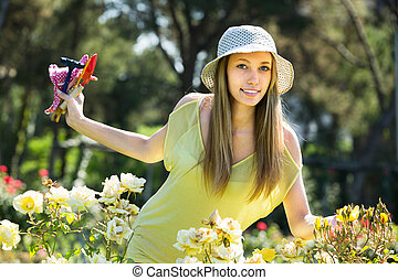 woman spending  free time in the garden
