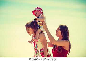 Woman spending time with kids on beach