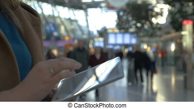 Woman spending time with tablet PC at the airport