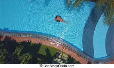 woman spends weekend time swimming in pool