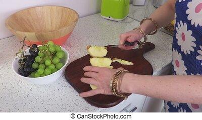 Woman split the apple in slices