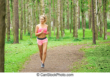 Woman sports, running in the park