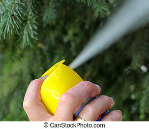 Woman spraying insects outdoor