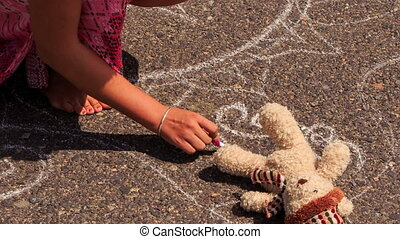 Woman Squats Draws with Chalk on Pavement by Toy Bear