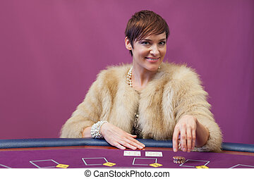 Woman stacking chips in a casino