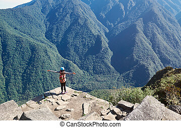 Woman stand on mountain cliff