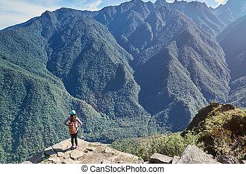 Woman stand on mountain peak