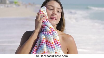 Woman standing and wiping with towel - Pretty young woman...
