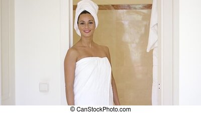 Woman standing at shower stall wrapped in towels - Beautiful...