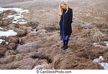 Woman standing at the swamp
