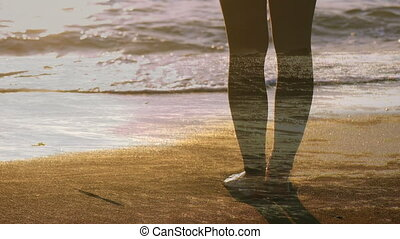 Woman standing barefoot on the beach