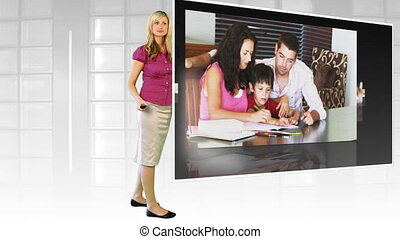 Woman standing before large TV screen - Young attractive...