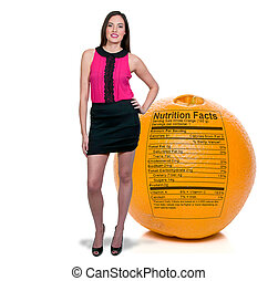 Woman Standing Behind Orange with Nutrition Label