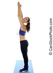 Full length portrait of young fit woman standing erect and stretching hands upwards.