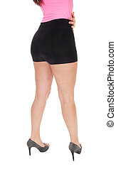Woman standing from back in black shorts