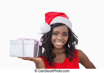 Woman standing holding a Christmas present