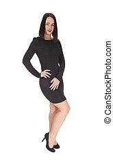 Woman standing in a black tight dress