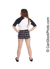 Woman standing in checkered shorts from the back