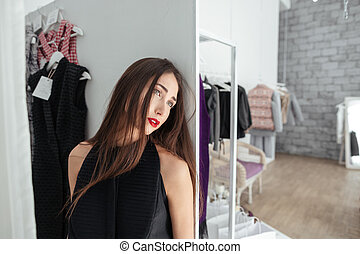 Woman standing in clothing store