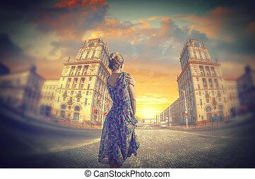 woman standing in dress.