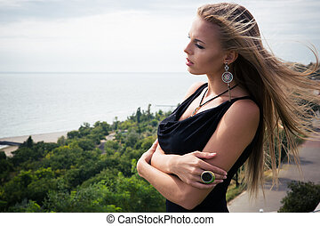 Woman standing in fashon dress outdoors
