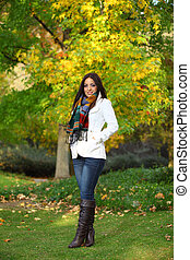 Woman standing in front of a colorful tree Autumn