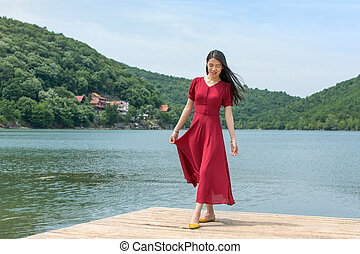 Woman standing in front of a lake