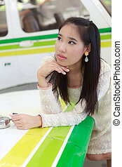 Woman standing in front of a light aircraft