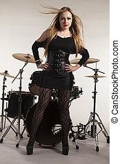 Woman standing in front of drumkit